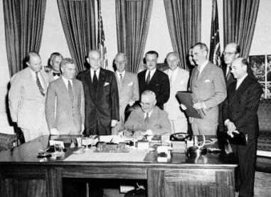 Truman signing the NATO agreement